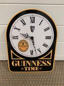 An enamel Guinness promotional wall clock