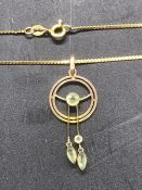 A 9ct gold pendant (1.2g) and an 18ct gold chain (2.2g)