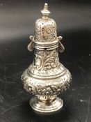 A Silver pepper pot, makers mark HM and indistinct hallmarks.