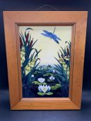 Moorcroft wall plaque in a pine frame