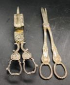 Two silver plated items, a candle wick trimmer/snuffer and a pair of grape scissors