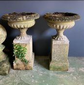 A pair of reclaimed stone urn planters on square plinth (H82cm Dia49cm Base 28cm)