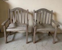 A pair of wooden garden chairs (H94cm W64cm D63cm)
