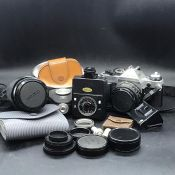 A Case of Camera Equipment to include a Canon AE-! camera with two lenses and assorted equipment