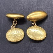 A pair of 15 ct gold gents cuff links (9.8g)