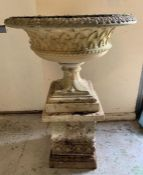 Reclaimed stone garden planter with lattice work around centre on square stone plinth (H56cm