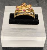 A 9 ct gold ring with eight small garnets