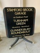 Tilt top table decorated with vintage London bus sign (H90cm W70cmsq)