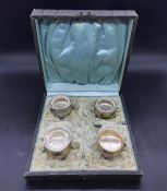 A Boxed set, incomplete liners and spoons, of continental silver salts.