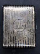 A Hallmarked silver card and cigarette case