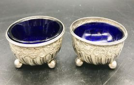 A Pair of silver, hallmarked, salts with blue glass liners