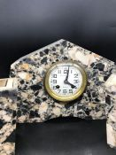 An Art Deco Marble Mantle Clock and Garniture