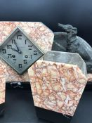 An Art Deco Marble Mantle Clock with garniture and figure of a dog.