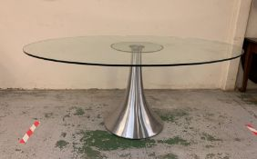 An Oval Glass Dining Table on Central stand