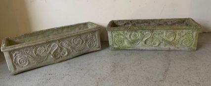 A pair of long garden planters with floral pattern to sides (84cm x 25cm)