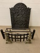A cast iron fire place back plate, cast with a coat of arms along with grate and fire dogs (H77cm