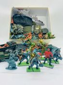 A selection of toy soldiers including Britains