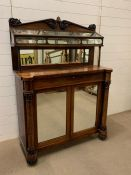 A Victorian mahogany chiffonier with a unique glazed display shelf with hinged lid and two