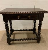 A Rectangular side table on spiral turned legs ad stretchers, turned feet with one drawer to