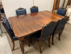 A large mahogany dining table, in the manner of Gillows with four turned tapering fluted legs