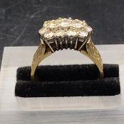 An 18 ct gold ring set with thirteen diamonds