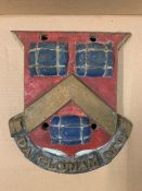 An Antique Cast Iron wall plaque for the Worshipful Company of Dyers, featuring 3 bags of madder (