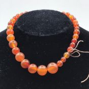 A graduated Amber beads necklace.