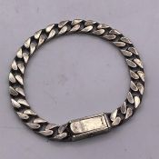 A Silver Gents Gucci Curb bracelet, marked 925.