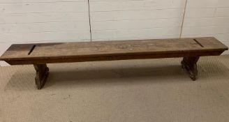 A long wooden bench seat (H43cm W233cm D31cm)
