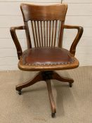 1930's swivel desk chair in original condition and leather seat