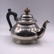 A Hallmarked silver teapot by Adie Brothers Ltd, Birmingham 1927 (Approximate weight 380g)