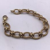 A 9ct yellow gold oval twisted wire effect link bracelet to a trigger clasp. Length 200 mm, width