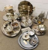 A Large volume of silverplated items to include wine bucket, wine coasters.
