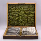 A Boxed set of six silver plated knives and forks