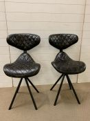 A Pair of Dark Leather chairs