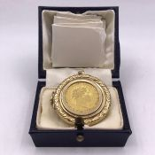 An 1820 sovereign in a 9ct gold case and on a 9ct gold chain (Total Weight 26g)