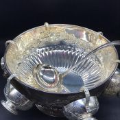 A Silverplated Punch Bowl with floral decoration.