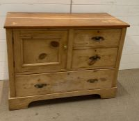 A pine two over one chest of drawers with a cupboard to side of drawers (H78cm W102cm D47cm)