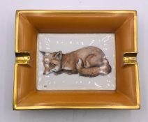 A Hermes china ashtray, with a hand painted fox.