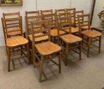 Thirteen oak school chairs