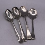 A Selection of four silver teaspoons (64g), various hallmarks and makers.