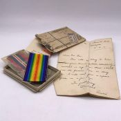 A Selection of WWI and WWII medal ribbons in orginal box.