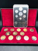 A Set of Armenian coins and a cased set of Russian medallions.