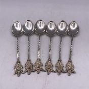 A Set of Six White Metal teaspoons.