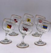 A set of six novelty tipsy glasses