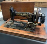 A Cased Antique Frister and Rossman sewing machine