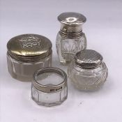 A Selection of four various silver topped jars, hallmarked.