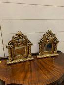 A pair of small gilt frame mirrors with cherubs (30cm x 25cm)