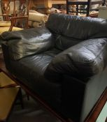 A Heal's Leather over sized armchair.