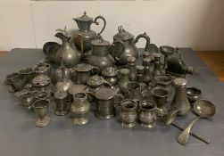 A Large volume of pewter items to include: measures, pepper pots, egg cups, salts, soup ladles,